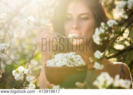 Pretty Vegan Woman With Dish Of Cherry Bloom Blossom Leaves. Healthy Eating Concept. Dieting, Vegete