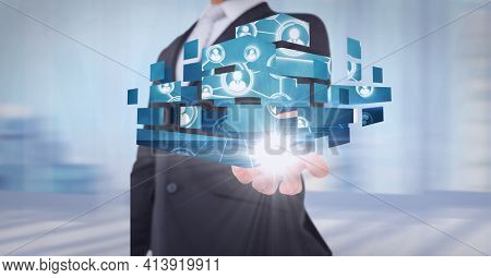 Composition of network of digital people icons over hand of businessman. global technology and digital interface concept digitally generated image.