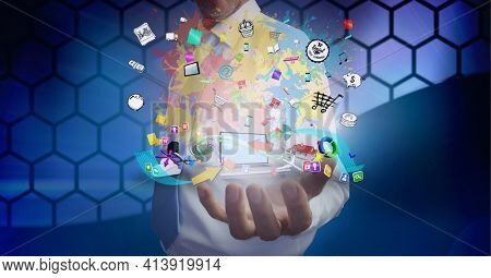 Composition of network of digital icons with laptop over hand of businessman. global technology and digital interface concept digitally generated image.