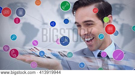 Composition of network of digital icons and photographs of people over smiling businessman. global technology and digital interface concept digitally generated image.