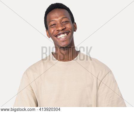 African American man in basic beige t-shirt studio shoot