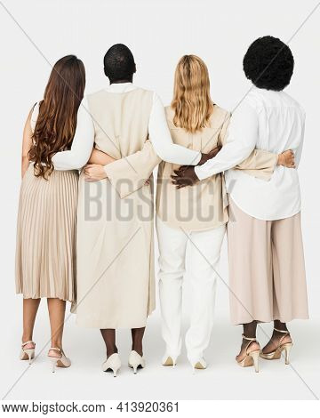 Diverse group of people wearing earth tone casual outfit for apparel ad