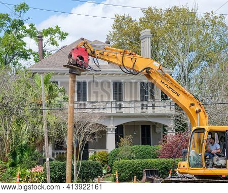 New Orleans, La - March 22: Man Operates Pile Driver  For New Construction In Uptown Neighborhood On