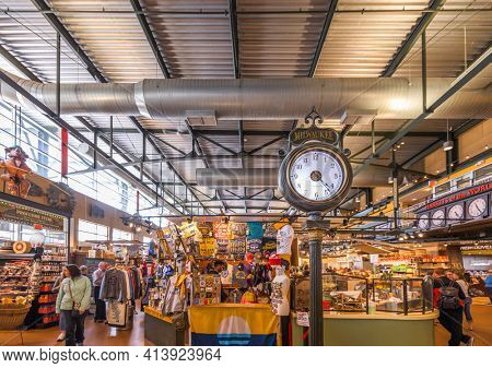 MILWAUKEE, WISCONSIN - MAY 19, 2018: Shoppers in the interior of Milwaukee Public Market. The market opened in 2005.