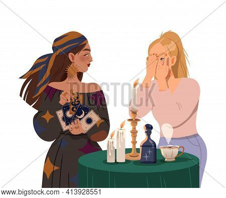 Gypsy Woman As Fortune Teller Holding Tarot Cards At Table With Candle Predicting Future To Girl Or