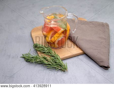 Refreshing Summer Homemade Cocktail With Grapefruit And Rosemary. Detox Citrus Infused Flavored Wate