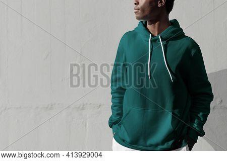 Man in green hoodie streetwear men's apparel fashion