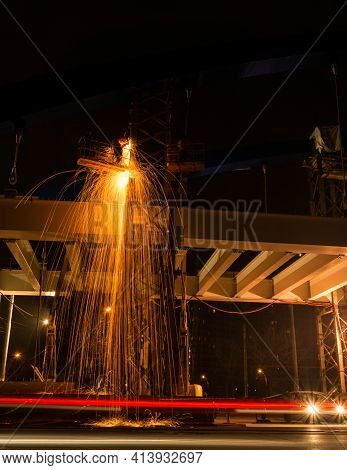 Wokers Welding During The Night For The Construction Of The Mihai Bravu Overpass In Bucharest