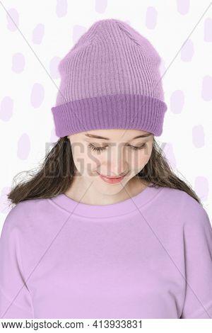 Teenage girl in purple beanie for teenage apparel shoot