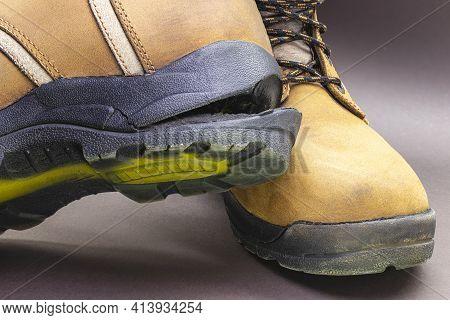 Torn Men's Leather Shoes. Torn Shoe Sole. Shoe Repair. Close-up