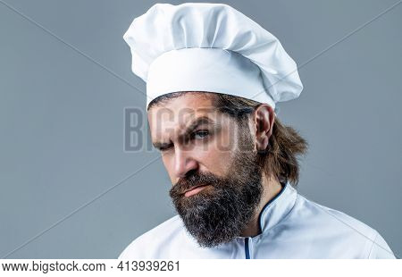 Cook Hat. Confident Bearded Male Chef In White Uniform. Portrait Of A Serious Chef Cook. Bearded Che