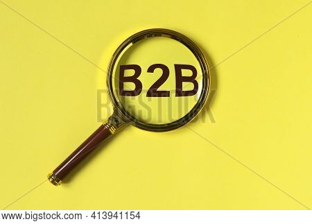 B2b Acronym, Inscription. Business To Business Concept Through Magnify On Trendy Yellow Background.
