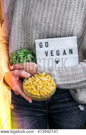 Lightbox With Text Go Vegan In Female Hands. Veganism, Vegetarian Healthy Lifestyle. Frozen Food In