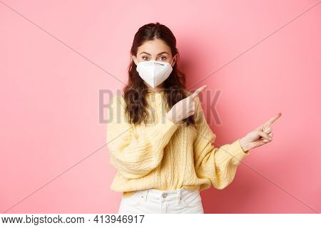 Covid, Corona And Social Distancing Concept. Excited Female Model In Respirator Shows You Advertisem