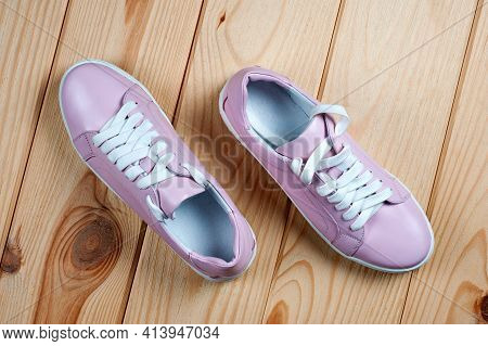 Light Pink Faux Leather Shoes Laced With Laces. Close-up Shot.