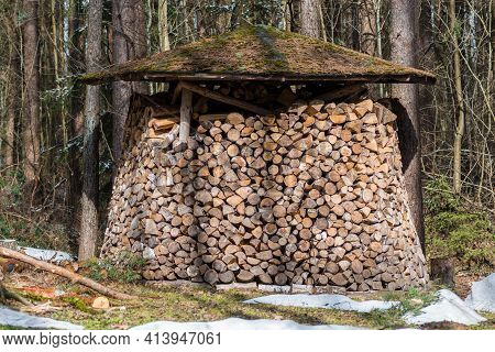 Circular Or Cylindrical Structure Or Stack Composed Of Blocks, Pieces Or Logs Of Wood And Roof In Wi
