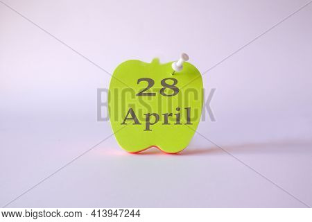 Calendar For April 28 : The Name Of The Month Of April In English, The Numbers 28 On The Sheets For