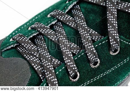 Dark Green Suede Shoes Laced With Laces. Close-up Shot.