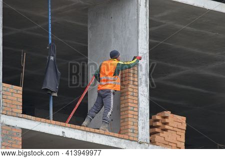 Kyiv Ukraine - March 16 2021: A Bricklayer Works At A Construction Site. Work Is Underway To Lay A R