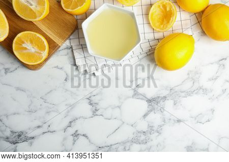 Freshly Squeezed Lemon Juice On White Marble Table, Flat Lay. Space For Text