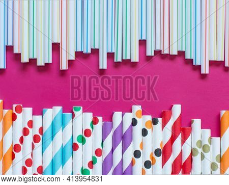 Modern Reusable Paper Drinking Straws As Alternative Replacement For Plastic Drinking Straws On Pink