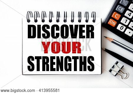 Discover Your Strengths. Text On White Notepad Paper On Light Background Near Calculator, Plant, Tab