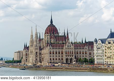 Budapest, Hungary, July 4: View Of The Parliament Building And The Danube Embankment With Tourists W