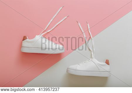 White Sneakers With Flying Laces. Pair Of Stylish Sneakers Comfortable Sportswear Hipster Womens Sho