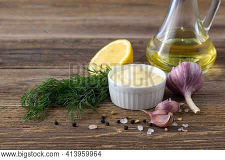 Mayonnaise Sauce With Garlic, Egg, Oil And Herbs On Natural Wooden Background