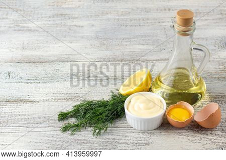 Mayonnaise Sauce With Garlic, Egg, Oil, Lemon And Herbs On White Wooden Background