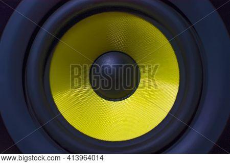 Macro Background: Yellow Sound Speaker. Music Equipment