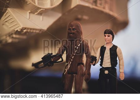 MARCH 23 2021: Star Wars Han Solo and Wookiee Chewbacca by the Millennium Falcon in Mos Eisley docking bay 94 - vintage Kenner figure and vehicle