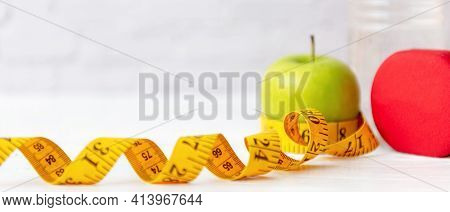 Close Up Measuring Tape.  Diet Health Planning And Workout For New Life. Sport Exercise Equipment Wo
