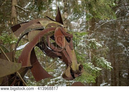 Vilnius, Lithuania - March 19 2021: Creepy Horse Face In A Wood, Rusted Iron Sculpture