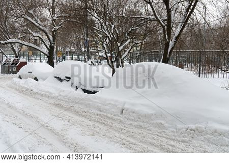 Cars Covered With Snow After A Hard Blizzard In Winter