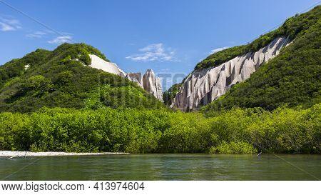 Pumice Rock Outcrops Near River. Kutkhins Baht In Kronotsky Reserve, Kamchatka Peninsula, Russia
