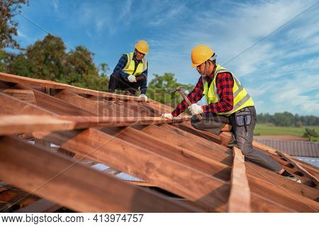 Roofer, Two Roofer Carpenter Working On Roof Structure On Construction Site, Teamwork Construction C