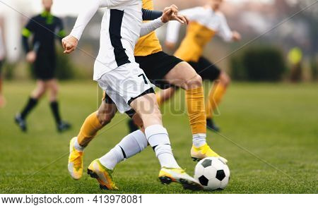 Adult Sports Players In Football Duel Run. Footballers Running Ball At The Game. Youth Soccer League