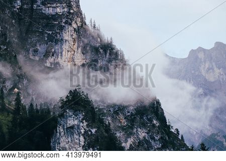 Morning Fog In Rainy Weather Covers The Peaks Of The Mountains In The Gesause National Park In Centr