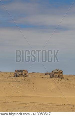 Kolmanskop. Namibia  - January 8.2021: Vertical View Over German Kolmanskop Ghost Town In Namibia Wi