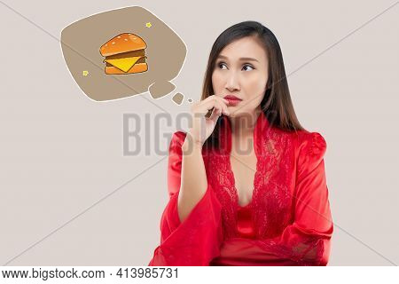 A Woman Want To Eat Hamburgers During The Night. When A Woman In A Red Satin Nightgown And Lace Robe