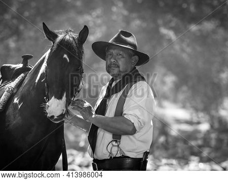 Old Cowboy Rested With A Horse In The Stream After He Finished Showering The Horse