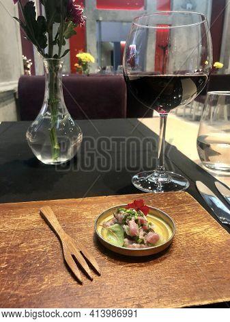 Athens, Greece - December 7, 2019: Steak Tartar Starter With Red Wine In 2 Mazi Restaurant In Athens