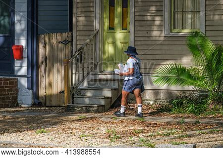 New Orleans, La - August 8: Mail Carrier Delivers Mail On Napoleon Avenue On August 8, 2020 In New O