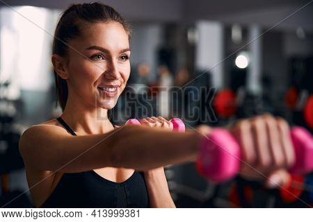 Focused Photo On Sportswoman Keeping Her Body Fit