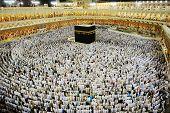 MECCA - JULY 21 : A crowd of pilgrims circumabulate (tawaf) Kaaba on July 21, 2012 in Mecca, Saudi Arabia. Pilgrims circumambulate the Kaaba seven times in counterclockwise direction. poster