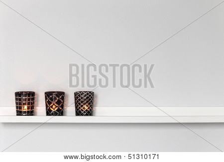 Candle Lights On White Shelf