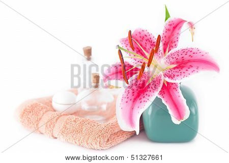 Beautiful Lily In A Vase, Towel And Cosmetic Containers