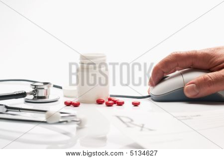 Prescription Medicine And Pharmacist Hand On Computer Mouse