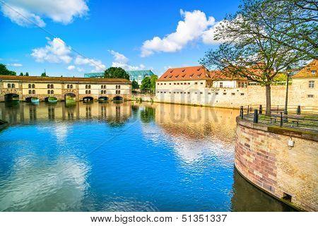 Strasbourg barrage Vauban and medieval bridge Ponts Couverts and reflection Barrage Vauban. Alsace France. poster
